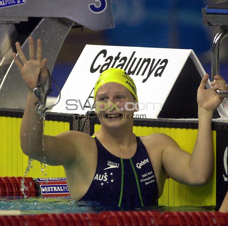 Pix: Matthew Lewis/SWpix.com. Swimming. 10th Fina World Championships 2003, Barcelona. 21/07/2003...COPYRIGHT PICTURE>>SIMON WILKINSON>>01943 436649>>..Australia's Liesel Jones celebrates her world record in the Womens 100m Breaststroke semi-final.