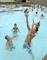 NWA Democrat-Gazette/BEN GOFF @NWABENGOFF<br /> Zane Kessler, 11, of Fayetteville shoots as Jackson Folds, 8, of Conway defends while playing basketball in the pool on Sunday Sept. 6, 2015 at the Rogers Aquatic Center. The water park will be open for the last day of the 2015 season on Monday from 11:00a.m. to 7:00p.m.