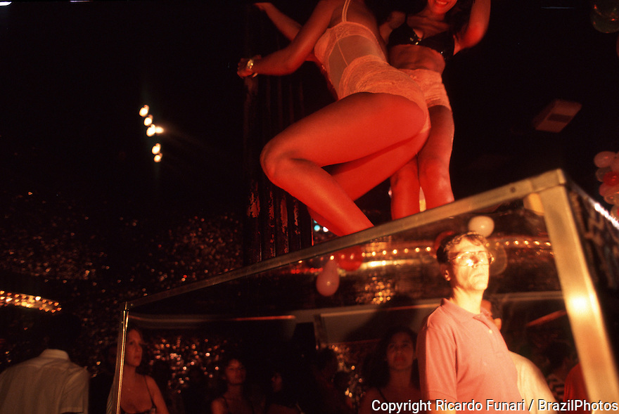 Rio de Janeiro, Brazil. Sexual tourism. Foreign tourist looks at prostitute women in the ballroon. Carnival, sex workers, revelers, carousers, sensuality.