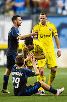 Danny O'Rourke (5) and Josh Williams (3) of the Columbus Crew argue withAntoine Hoppenot (29) of the Philadelphia Union. The Columbus Crew defeated the Philadelphia Union 2-1 during a Major League Soccer (MLS) match at PPL Park in Chester, PA, on August 29, 2012.