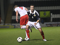 David Turpel pressured by Dnny Wilson in the Scotland v Luxembourg UEFA Under 21 international qualifying match at St Mirren Park, Paisley on 6.9.12.