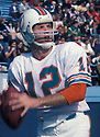 Miami Dolphins Bob Griese (12), in action during a game from the 1975 season. Bob Griese was inducted to the Pro Football Hall of Fame in 1990.