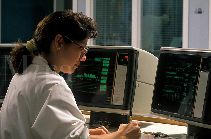 Portrait of a nurse at at cardiac intensive care (ICU) nurses station.