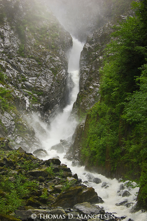 Water cascades down Boliver Falls in Knight Inlet, British Columbia, Canada.