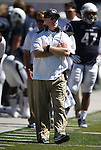 Nevada Head Coach Brian Polian works the sidelines of an NCAA college football game against Southern Utah on Saturday, August 30, 2014 in Reno, Nev. (AP Photo/Cathleen Allison)