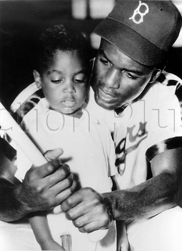 "1948. Jackie Robinson and son, 1948 in one of the photographs included in the new book, ""Harlem: The Vision of Morgan and Marvin Smith."