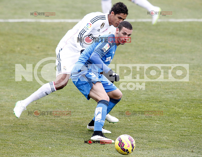 Getafe's Alvaro Vazquez (r) and Real Madrid's Raphael Varane during La Liga match.January 18,2013. (ALTERPHOTOS/Acero) /NortePhoto<br /> NortePhoto.com