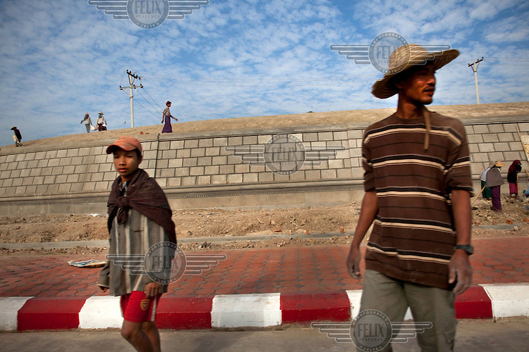 Day labourers work on a road construction project in Naypyitaw, the new capital of Burma (Myanmar) since November 2005.