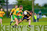 Gneeveguilla's Fergus McAuliffe puts the pressure on John Payne of Dr Crokes in Gneeveguilla last Sunday evening in round 1 of the Garvey's Supervalue County Senior Championship.