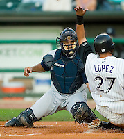 Charlotte catcher Wiki Gonzalez (23) tags Louisville shortstop Pedro Lopez (27) out at the plate at Louisville Slugger Field in Louisville, KY, Tuesday, June 5, 2007.