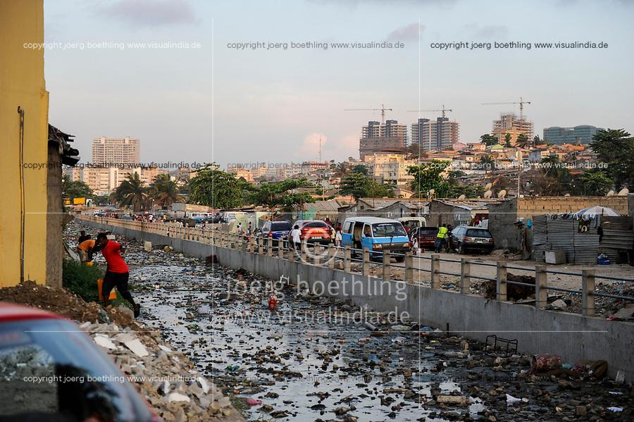 ANGOLA Luanda, due to revenues from oil and diamond exports a construction boom is seen everwhere and the real estate prices are extremely high, in contrast slum and polluted canal /ANGOLA Luanda , durch Einnahmen aus Oel und Diamanten Exporten gibt es einen gigantischen Bauboom und Luanda rangiert als einer der teuersten Immobilienplaetze weltweit,  im Kontrast Slum und verschmutzter Kanal