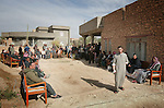 Relatives and neighbors gather around the shrouded bodies of what they say to be civilians killed during fighting between insurgents and Marines in Haditha, Iraq on Tues. Nov. 12, 2005. One Marine was killed during the clash which also left several wounded.