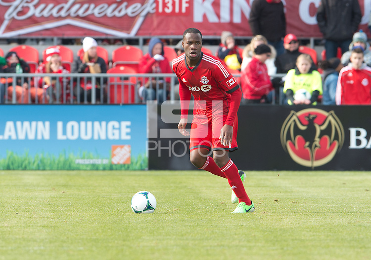 06 April 2013: Toronto FC defender Gale Agbossoumonde #6 in action during an MLS game between FC Dallas and Toronto FC at BMO Field in Toronto, Ontario Canada..The game ended in a 2-2 draw..