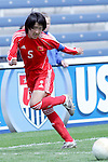 27 August 2006,  Pu Wei (CHN) redirects the ball to keep it inbounds.  The USA Women's National Team defeated China by a score of 4-1 in an international friendly match at Toyota Park, Bridgeview, Illinois.