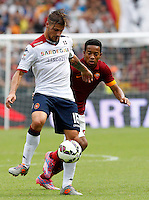 Calcio, Serie A: Roma vs Cagliari. Roma, stadio Olimpico, 21 settembre 2014.<br /> Cagliari midfielder Daniele Dessena, left, is challenged by Urby Emanuelson during the Italian Serie A football match between AS Roma and Cagliari at Rome's Olympic stadium, 21 September 2014.<br /> UPDATE IMAGES PRESS/Riccardo De Luca
