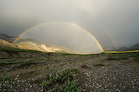 A double rainbow forms on a summer evening over the Hulahula River at Grasser's Strip in Alaska's Arctic National Wildlife Refuge.