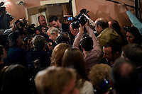 Members of the media surround congressman Ron Paul after a town hall meeting and rally at the Church Landing at Mills Falls hotel in Meredith, New Hampshire, on Jan. 8, 2012. Paul is seeking the 2012 Republican presidential nomination.