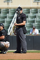 Home plate umpire Colin Baron checks his clicker during the South Atlantic League game between the Delmarva Shorebirds and the Kannapolis Intimidators at Kannapolis Intimidators Stadium on May 19, 2019 in Kannapolis, North Carolina. The Shorebirds defeated the Intimidators 9-3. (Brian Westerholt/Four Seam Images)