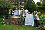 St Mary's Church Kemsing Kent Uk. St Edith's Day, the uncovering of the Well Dressing.  Kemsing was the birthplace in AD961 of Saint Edith of Wilton an illegitimate daughter of the Saxon King Edgar I. The well at the centre of the village is dedicated to her according to local local legend her saintly presence has given the water healing properties. Annual pilgrimage to Well September 2014.