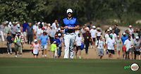 Rory McIlroy (NIR) is pursued by a gallery of spectators on foot during the Final Round of the 2016 Omega Dubai Desert Classic, played on the Emirates Golf Club, Dubai, United Arab Emirates.  07/02/2016. Picture: Golffile | David Lloyd<br /> <br /> All photos usage must carry mandatory copyright credit (&copy; Golffile | David Lloyd)