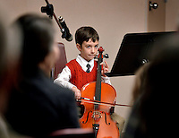 STAFF PHOTO BEN GOFF  @NWABenGoff -- 12/13/14 Bennett Hudson, 7, of Springdale performs a solo holiday tune on the cello during the Will Bush Violin Studio holiday recital at the Shiloh Museum of Ozark History in Springdale on Saturday Dec. 13, 2014.