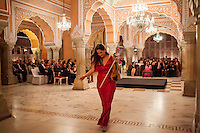 Australian violinist Niki Vasilakis exits the stage after playing the violin to a prominent audience, including the Jaipur Royal Family, and other VIPs during a recital at the OzFest Gala Dinner in the Jaipur City Palace, in Rajasthan, India on 10 January 2013. Photo by Suzanne Lee