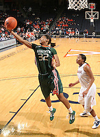 Jan. 6, 2011; Charlottesville, VA, USA; Miami Hurricanes forward Morgan Stroman (32) grabs a rebound in front of Virginia Cavaliers guard Whitny Edwards (2) during the game at the John Paul Jones Arena. Miami won 82-73. Mandatory Credit: Andrew Shurtleff