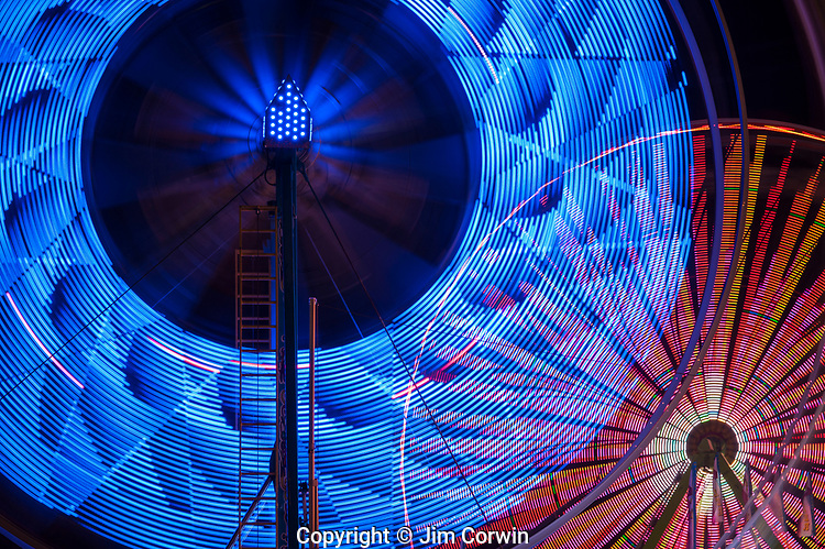 Ferris wheel in motion with multicolors and abstract patterns of colors