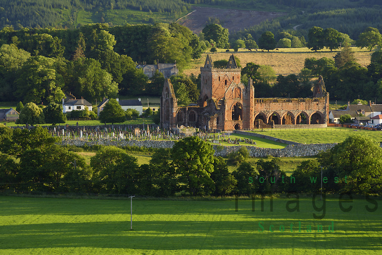 Summer evening light on the romantic ruins of Sweetheart Abbey in a scenic landscape at New Abbey near Dumfries Scotland UK