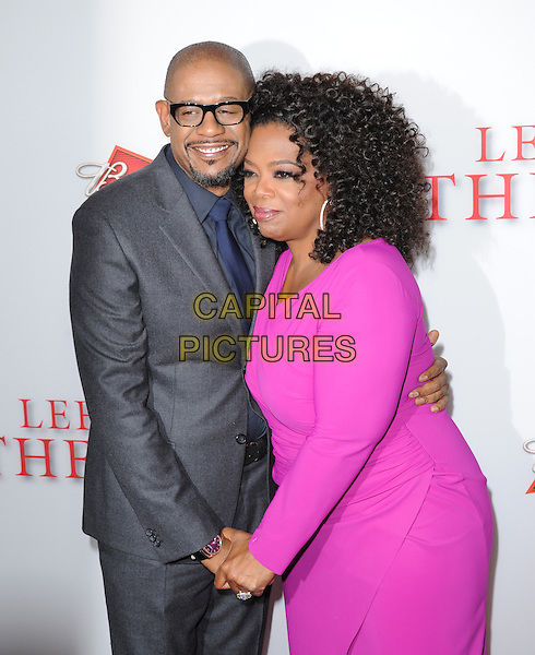 Forest Whitaker &amp; Oprah Winfrey<br /> &quot;Lee Daniels' The Butler&quot; Los Angeles Premiere held at Regal Cinemas L.A. Live, Los Angeles, California, USA.        <br /> August 12th, 2013    <br /> half length pink dress holding hands grey gray suit jacket blue shirt glasses  goatee facial hair <br /> CAP/DVS<br /> &copy;DVS/Capital Pictures