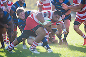 Lepetimalo Lauese powers towards the tryline despite Kaleb Footes best efforts to stop him. Counties Manukau Premier Club Rugby game between Karaka and Onehwero played at Karaka Sports Park on Saturday May 7th 2016. Karaka won the game 46 - 9 after leading 20 - 9 at half time. Photo by Richard Spranger.