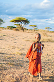 TANZANIA, Arusha National Park, a Maasai girl wearing orange traditional cloths