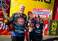 Oct 14, 2019; Concord, NC, USA; NHRA top alcohol dragster driver Megan Meyer celebrates with father Randy Meyer after clinching the 2019 championship after winning the Carolina Nationals at zMax Dragway. Mandatory Credit: Mark J. Rebilas-USA TODAY Sports