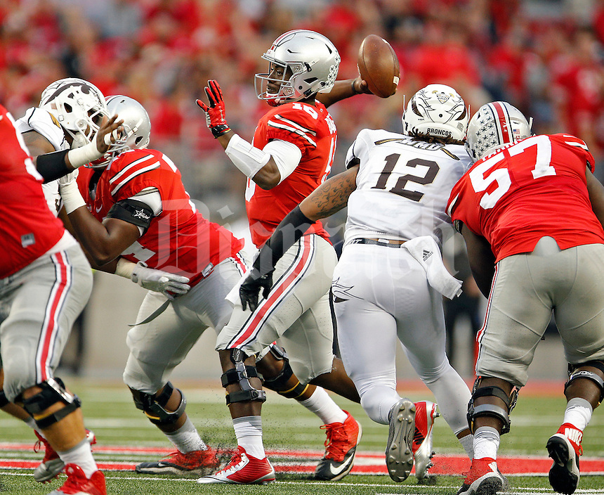 Ohio State Buckeyes quarterback J.T. Barrett (16) throws an interception against Western Michigan Broncos defense in the 4th quarter of their game at Ohio Stadium on September 26, 2015.  (Dispatch photo by Kyle Robertson)