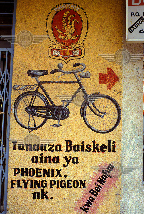Hand-painted sign advertising chinese bicycles.