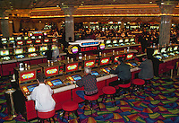People gambling inside a casino. Las Vegas, Nevada.