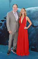 HOLLYWOOD, CA - AUGUST 06: Director Jon Turteltaub (L) and Amy Eldon attend the premiere of Warner Bros. Pictures and Gravity Pictures' Premiere of 'The Meg' at the TLC Chinese Theatre on August 06, 2018 in Hollywood, California.<br /> CAP/ROT/TM<br /> &copy;TM/ROT/Capital Pictures