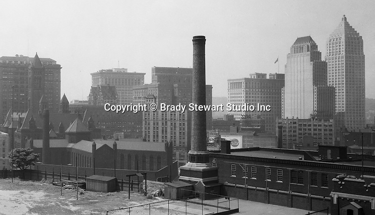 Pittsburgh PA:  View of downtown Pittsburgh from the bluff at Duquesne University - 1932.  View includes the new Gulf Building, City County Building and Jail, Frick Building, Henry Oliver building, Koppers Building, William Penn Hotel and Bell Telephone Building