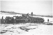 New Mexico Lumber Co. #4 (ex-D&amp;RGW #227) rolled over on soft track on the Long Draw Branch.<br /> New Mexico Lumber Co.  Long Draw Branch, CO  Taken by Long, Morris - 3/24/1928