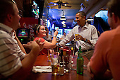 United States President Barack Obama has a beer with patrons at the Pump Haus Pub and Grill in Waterloo, Iowa, August 14, 2012. .Mandatory Credit: Pete Souza - White House via CNP