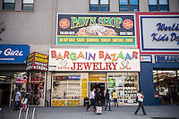 Pawn shop/ jewelry store in Downtown Brooklyn in New York on Sunday, September 29, 2013. The area has been for years a middle and lower economic shopping strip but because of increased development in the area, notably hi-rise luxury apartment buildings, chain stores and high-end retailers are moving in. Rents are rising and the smaller mom and pop stores, as well as regional chains are being forced out.  (© Richard B. Levine)