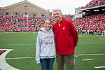 Wisconsin Badgers honorary captain Pat Richter (right) poses with junior captain Maddie Mitchell prior to an NCAA college football game against the San Jose State Spartans on September 11, 2010 at Camp Randall Stadium in Madison, Wisconsin. The Badgers beat San Jose State 27-14. (Photo by David Stluka)