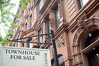 Sign for townhouse for sale in the Upper West Side nieghborhood of New York on Sunday, April 30, 2017. (© Richard B. Levine)
