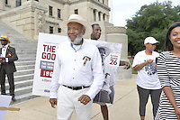 "Civil Rights icon James Meredith, 83, walks from the Smith Robertson museum in downtown Jackson MS. to the State Capitol to commemorate the 50th Anniversary of his historic Walk Against Fear in 1966. Meredith was shot on the second day of his walk in 1966 in Hernando MS and Dr. Martin Luther King and other major civil rights leaders of the time continued Meredith's March from Memphis to Jackson which ended at he Mississippi State Capitol on June 26, 1966 with 15,000 marchers. The Meredith March was the largest civil rights march ever in the state of Mississippi.  The Smith Robertson Museum has an exhibit all about Meredith's March called ""Am I or Am I Not  A Citizen."" and Meredith spoke and signed books at the museum before the walk to the state capitol. Photo©Suzi Altman"
