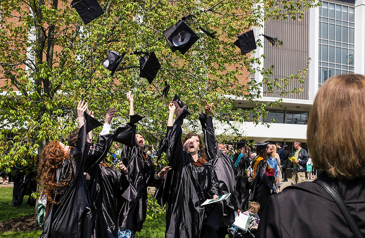 A group of students toss their mortar boards into the air following Ohio University's Graduate Commencement on Friday, May 1, 2015.  Photo by Ohio University  /  Rob Hardin
