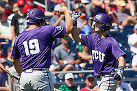 TCU Horned Frogs second baseman Cam Warner (4) is greeted by teammate Luken Baker (19) after hitting a home run against the Texas Tech Red Raiders in Game 3 of the NCAA College World Series on June 19, 2016 at TD Ameritrade Park in Omaha, Nebraska. TCU defeated Texas Tech 5-3. (Andrew Woolley/Four Seam Images)