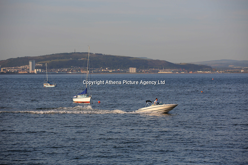 WEATHER PICTURE WALES<br />Pictured: A speed boat in Mumbles, south Wales UK. Tuesday 16 August 2016<br />Re: High temperatures and sunshine experienced in most of the UK.