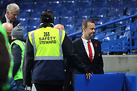 A Chelsea safety steward opens a gate for Ed Woodward, Chief Executive of Manchester United during Chelsea vs Manchester United, Premier League Football at Stamford Bridge on 5th November 2017