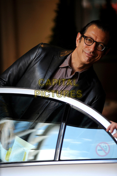 JEFF GOLDBLUM.Leaving his London hotel, London, England..May 27th, 2010.half length glasses black jacket leather purple pink car door.CAP/DYL.©Dylan/Capital Pictures.