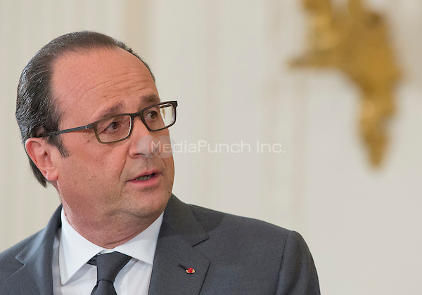 President Francois Hollande of France answers a reporter's question as he and United States President Barack Obama conduct a joint press conference in the East Room of the White House in Washington, DC on Tuesday, November 24, 2015. The leaders agreed on the need to contain ISIL.<br /> Credit: Ron Sachs / CNP /MediaPunch